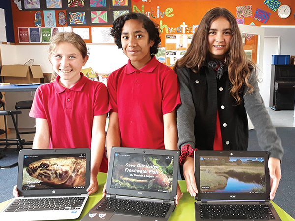 Students from Hikurangi School researched a kete of knowledge about Northland's endemic mudfish. Ashley, Aaliyah and Dahlia show some of their findings.