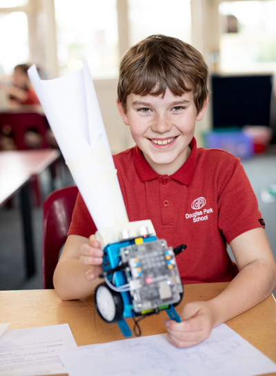 Ashton (10) combined low and high tech in the first prototype of a robot (M-Bot) golf ball collector.