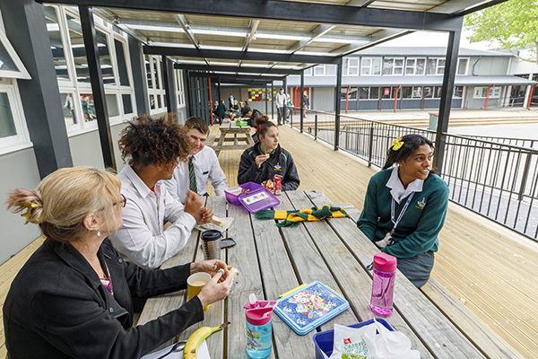 The verandah provides a seamless inclusive space where all students can gather. Two First XV students, Charlee and James (Year 13), build connections with Deborah and Voncie from the Lighthouse Programme. Specialist teacher Lara Henwood mentors with social coaching.