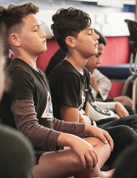 Students at Kaiti School participate in a mindfulness exercise. Supplied by Pause Breathe Smile; credit: Brennan Thomas.