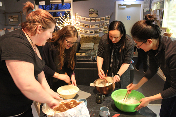 Kristy Forsyth, Penny Tattersfield, Carly Ashford and Shan Wang (Aylin) make Chinese steamed buns during a regular cooking evening, which brings whānau from diverse cultures together.