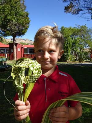 Jake had a go at raranga (weaving) as part of the creative project.